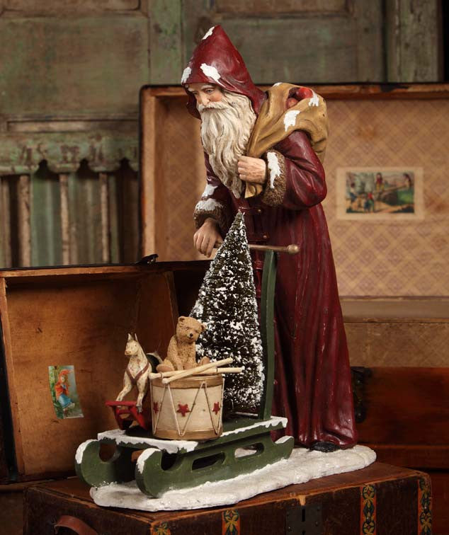 Santa Pushing Sled Table Piece