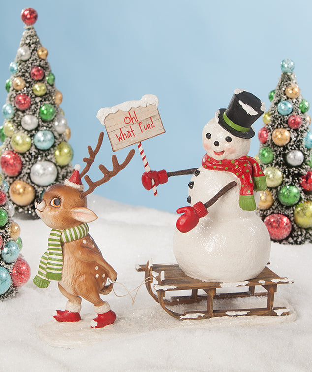 Oh What Fun! Reindeer Pulling Snowman on Sled
