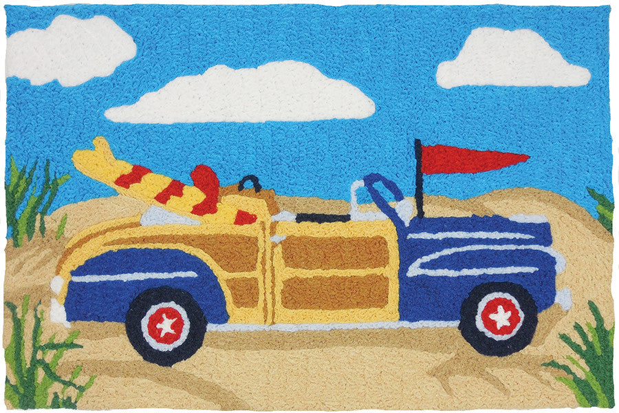 Blue Woodie Convertible Rug at the Beach with Surf Board