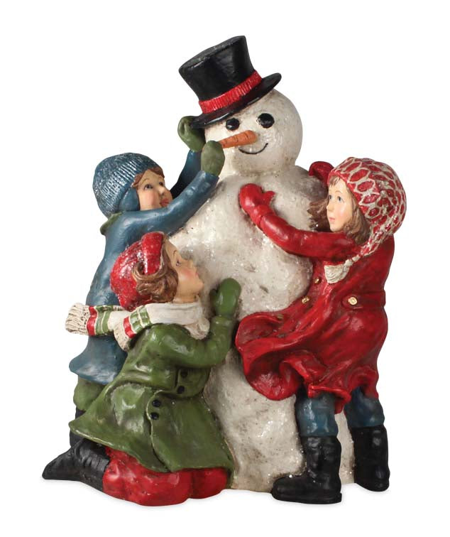 Building a Snowman Figurine - Saturday Evening Post Christmas