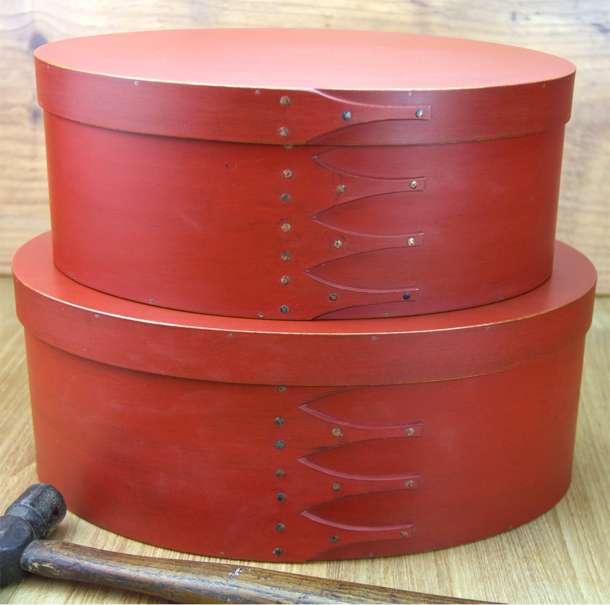 Stack of Red Oval Shaker Boxes