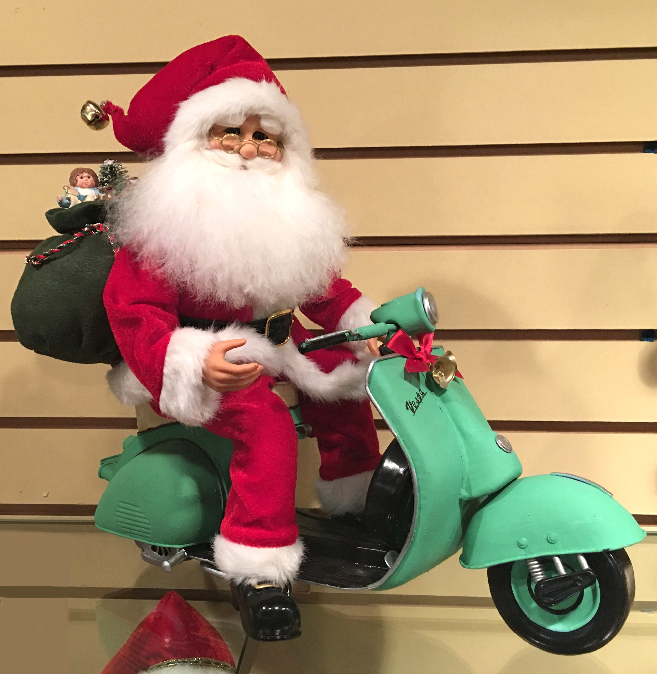 Santa on a Motor Scooter - Karen Didion