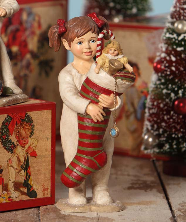Girl Holding Christmas Stocking Figurine | Saturday ...