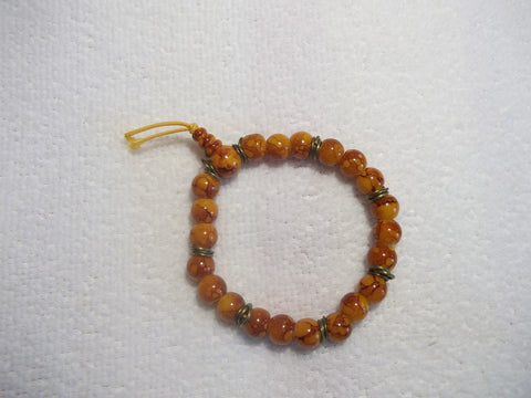 Orange Swirl Glass Bead Bronze Stretchy Bracelet (B391)