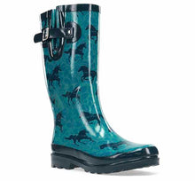 Womens tall rain boot with dark horse print, side buckle, and small heel.