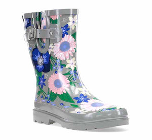 Mid-calf rain boots with big flower blossoms in pink and purple, side buckle, and pull tab.
