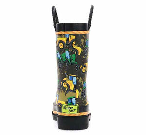 A printed rubber rain boot with yellow and green tractors on a taupe background with tire-tread pull handles.