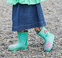 Leg shot of model with long skirt and kids rain boots featuring the Disney Princess Ariel.