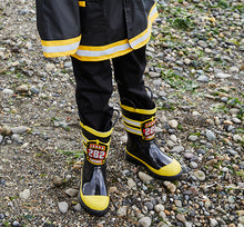Kid standing in Western Chief FDUSA rain boots and coat.