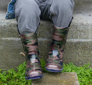 Leg shot of model wearing lighted rain boots in camo print from Western Chief.