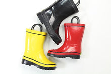 Studio shot of Western Chief Firechief 2 Rain Boots in yellow, black, and red.
