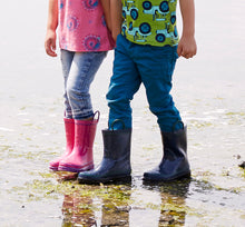 Leg shot of two kids wearing casual outfits and solid Western Chief Firechief 2 Rain Boots.