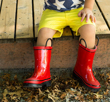 Leg shot of a Western Chief model in yellow shorts and our Firechief 2 Rain Boot in red.