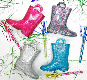 Posed selection of glitter rain boots from Western Chief.