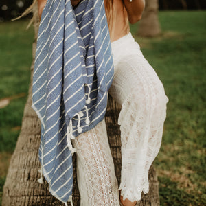blue towel with tassels