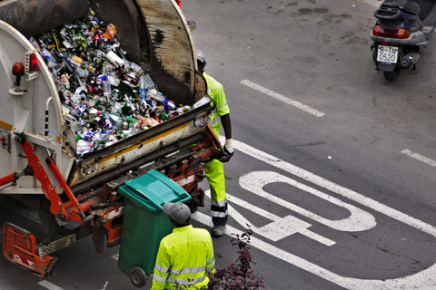 Recyclables Loaded Into Garbage Truck