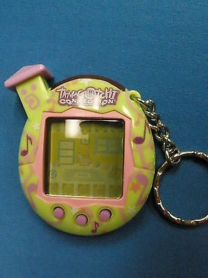 Tamagotchi Connection V5  Familtchi green pink music notes house