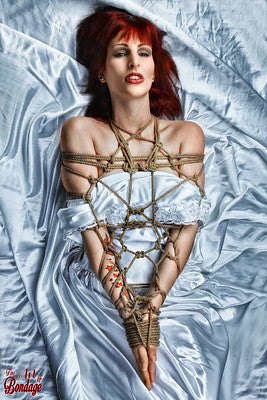 Woman with hands bound in front of her body with bondage rope.