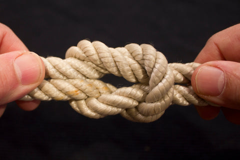 A knot in white rope.