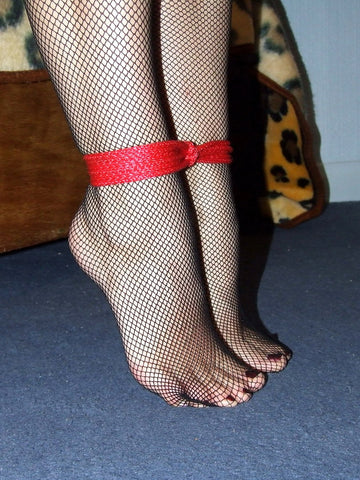 Self-tied ankles with fishnet stockings.