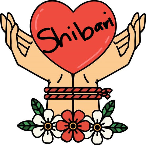 Rope bound hands holding a heart that says Shibari.
