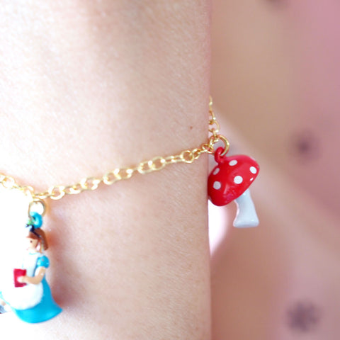 N2 - AMAL201 ALICE READING A BOOK CHARMS BRACELET
