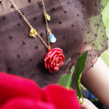 N2 - AIBE322 RED ROSE AND THE BEAUTY, THE BEAST AND CANDELARBRUM CHARMS LONG NECKLACE
