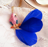 NB - U228 pink parrot on branch with feather necklace