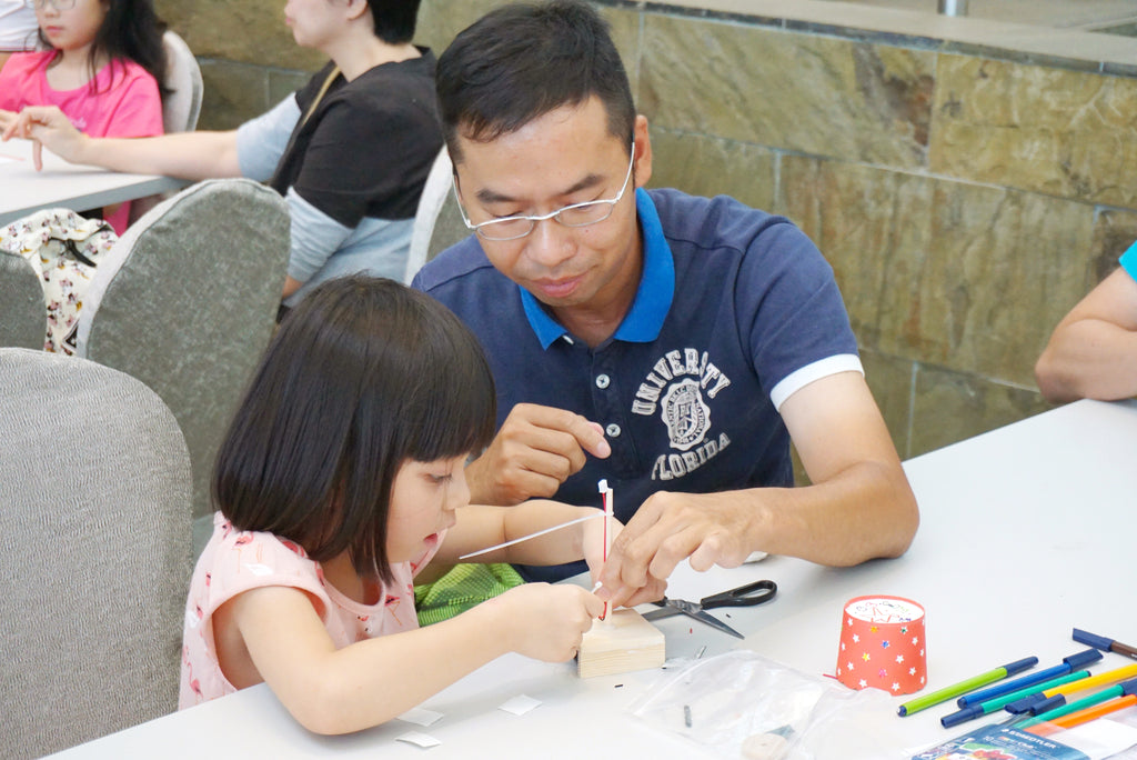 priceless father and daughter moment, lovely talented hong kong father dad teaching his daughter on how to assemble Mochy Kid bedside lamp, passing on the skills