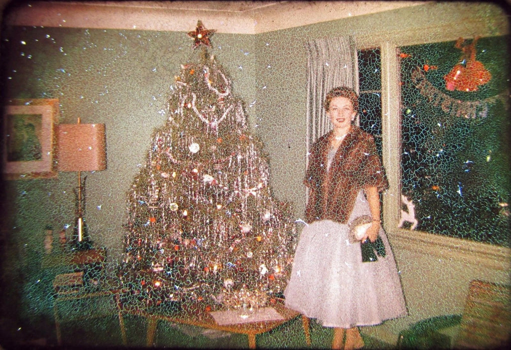 Vintage Christmas tree picture woman standing by
