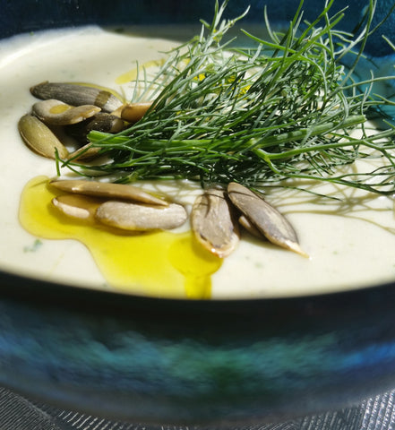 Chilled Avocado Soup topped with Toasted Pumpkin Seeds and Dill