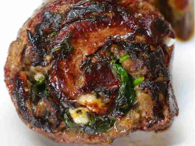 Greens Stuffed Flank Steak with Feta and Walnuts