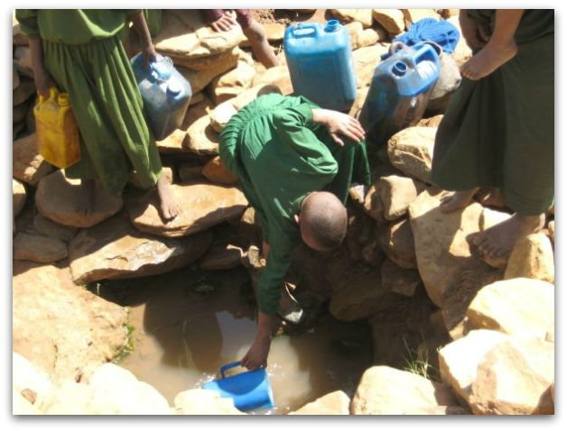 Ethiopian girls fetch water from a catchment
