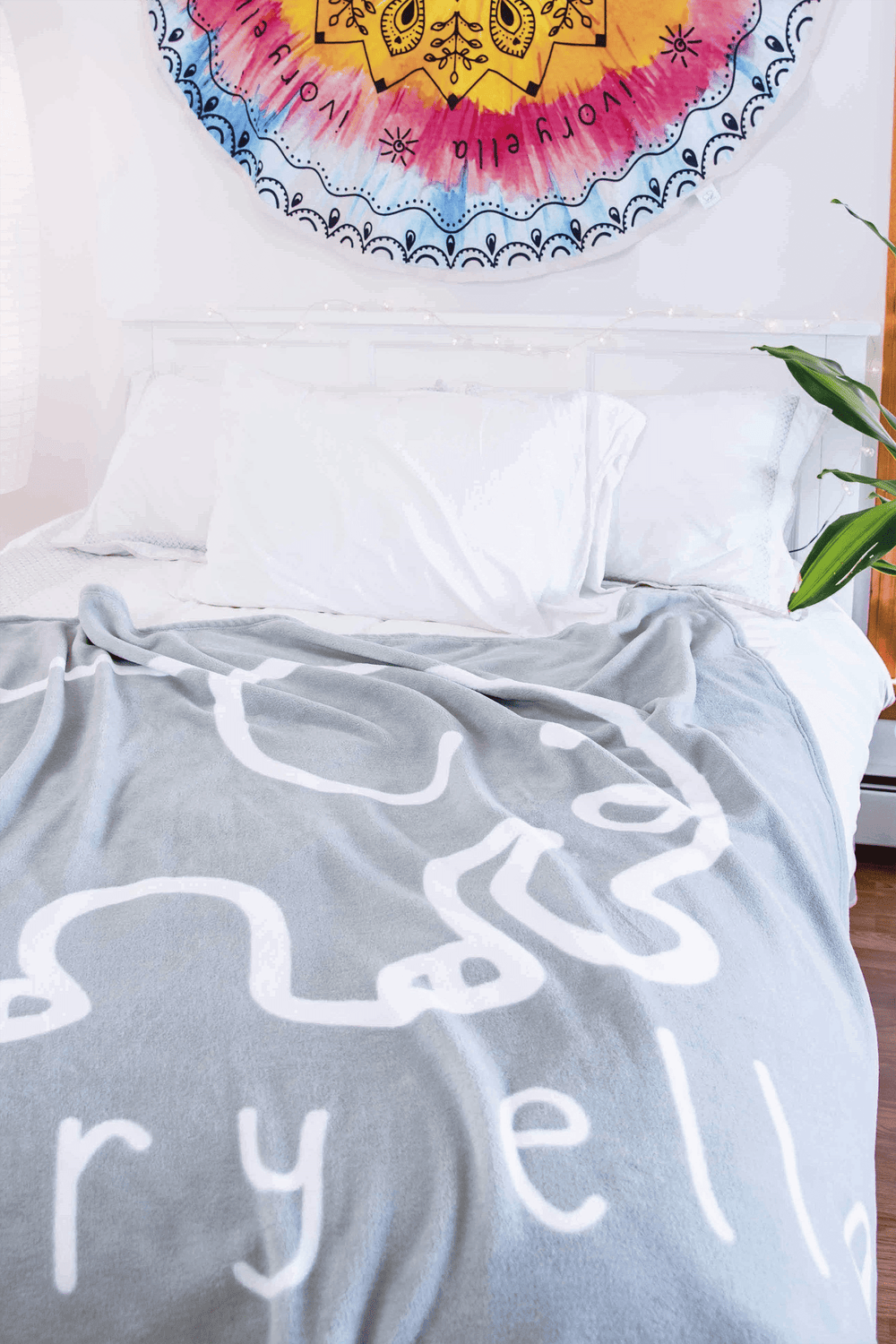 Elephant Blanket from Ivory Ella laid out on a bed in a girl's room