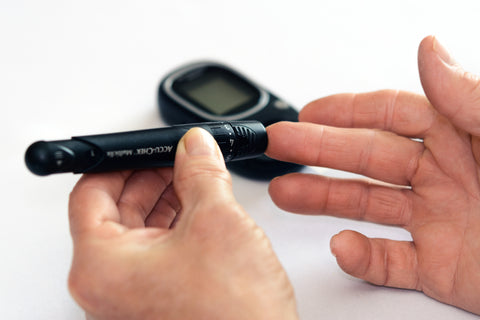 Person using blood sugar measuring device