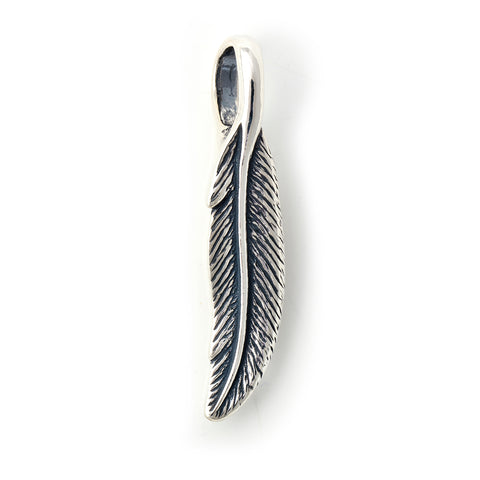"Curved Looking Small Feather Pendant ""1989 NAC"""