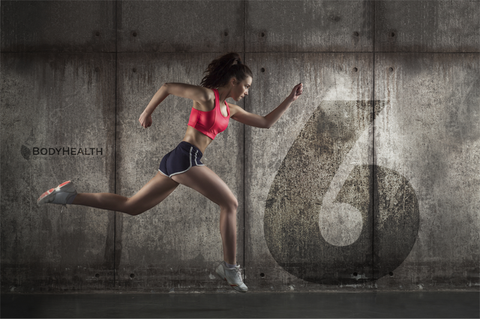 Woman Sprinting Industrial Background