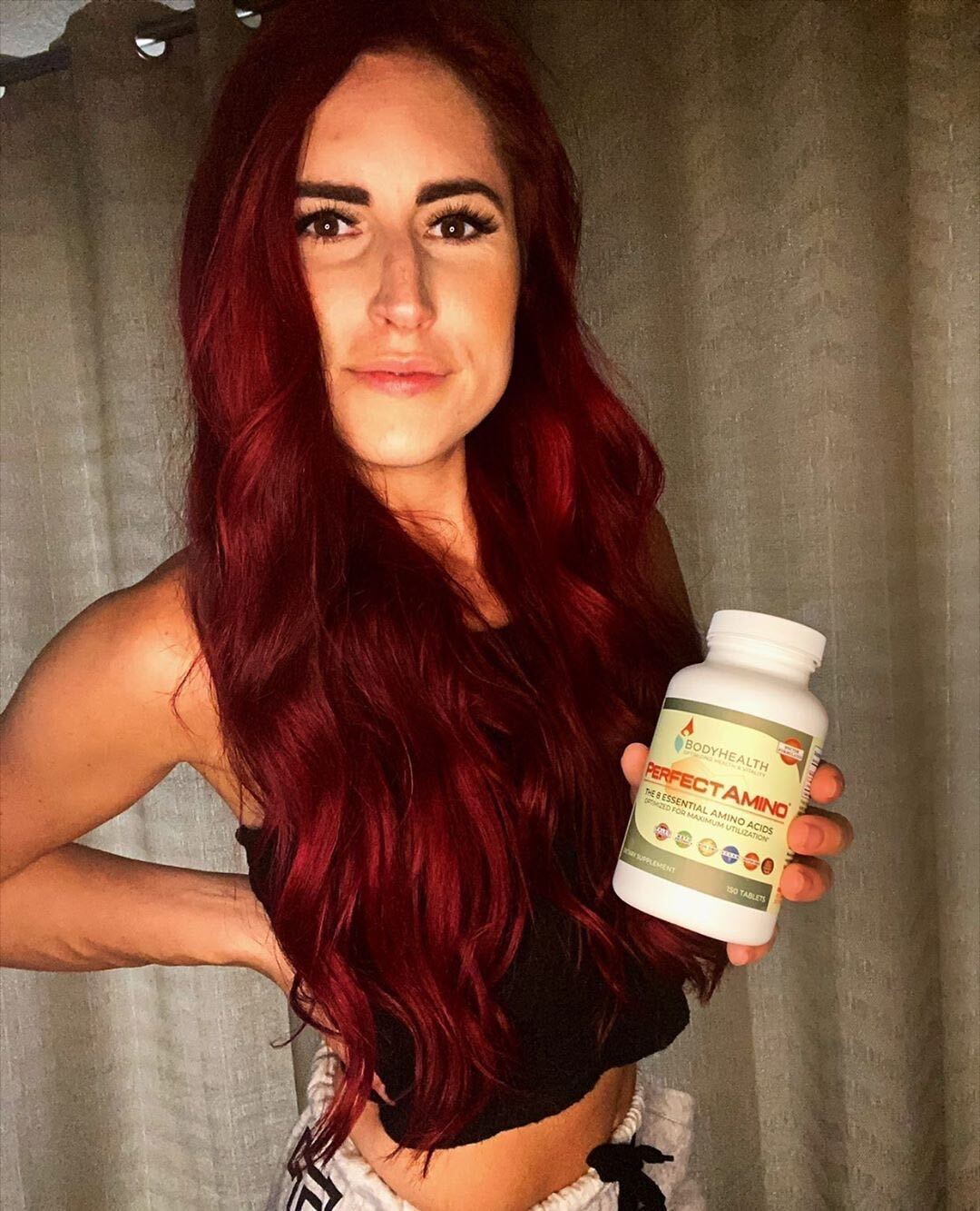 BodyHealth Woman Influencer holding PerfectAmino 150 count bottle of tablets for toned and lean muscle