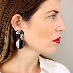 Pinwheel silver black clip on leather earrings