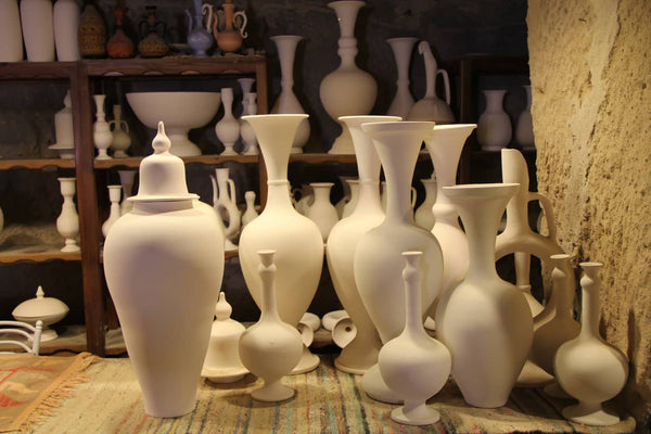 white ceramic pots with shadow