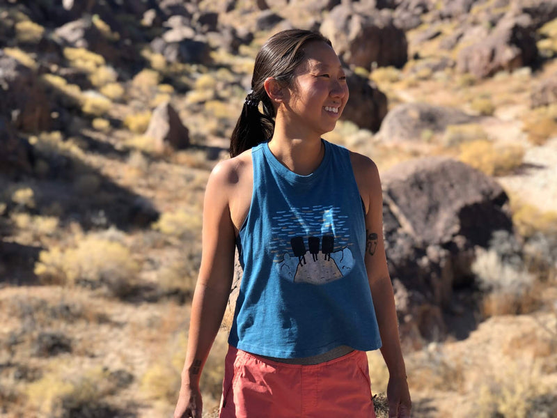 Leslie Kim Owner Founder of Dynamite Starfish Rock Climbing Apparel Company. Wearing a Sunset Boulderers Crop tank in Bishop, CA at the Happy Boulders