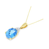 1.53ctw 6 x 8 mm. Oval Genuine Natural Blue Topaz and Diamond Pendant 14kt Yellow Gold