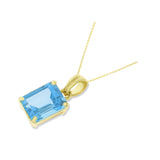 2.13ctw 6 x 8 mm. Emerald Cut Genuine Natural Blue Topaz Pendant 14kt Yellow Gold