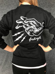 FEELINGS:  HAND on black fleece pullover