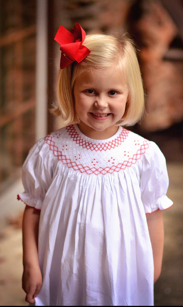 Classic White Bishop Dress with Red Geometric Smocking