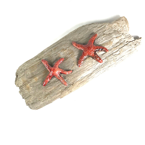 TWO RED/BLUE RAKU SEA STARS ON DRIFTWOOD WALL HANGING