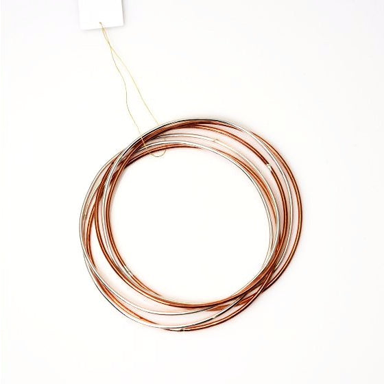 STERLING SILVER AND COPPER SIX RING BANGLE
