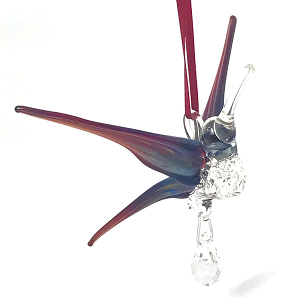 Glass hummingbird with crystal and red/blue tone wings