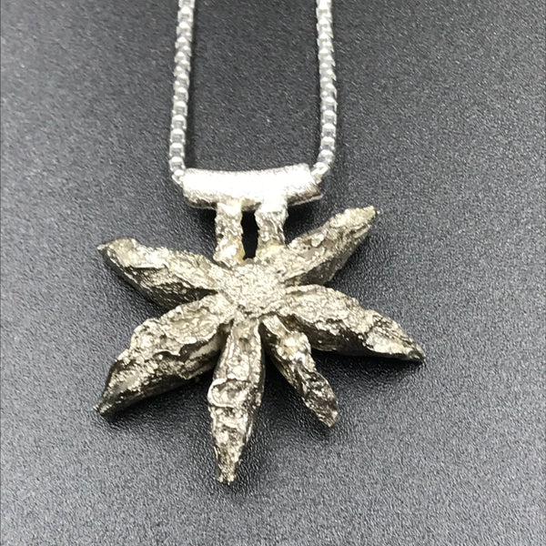 Sterling Silver design of a Star Anise Seed Pendant Necklace