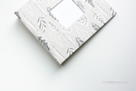 Grey and White Feathers Modern Baby Book - Our Story Paper Co.
